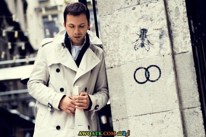 بوستر الفنان التركي سيركان التنوراك