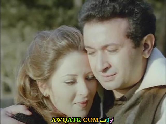 صورة الفنانة المصرية بوسي وزوجها نور الشريف