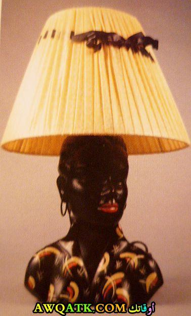 أباجورة علي شكل تمثال رأس أمراة