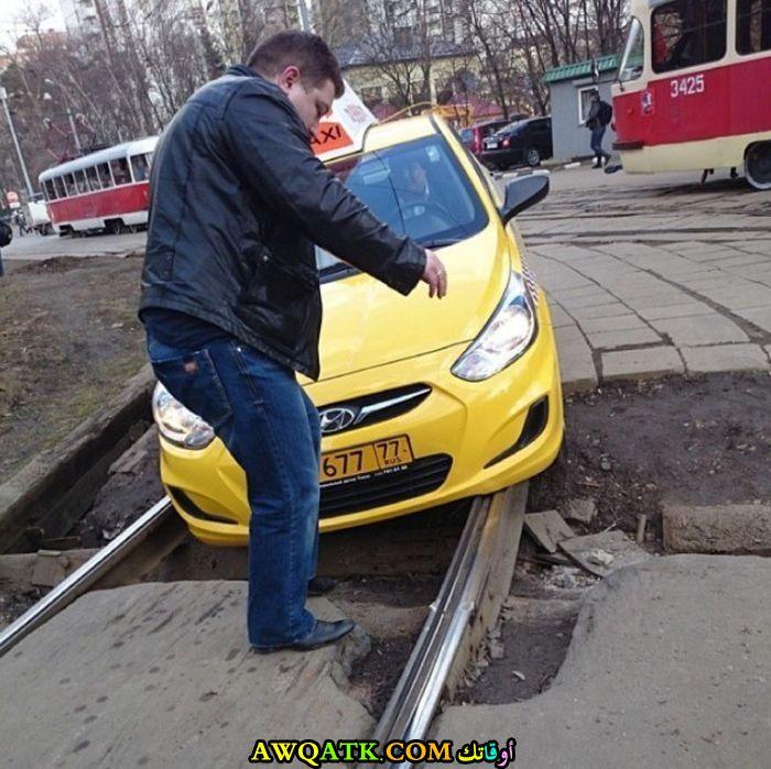 السيارات وسكة الترام