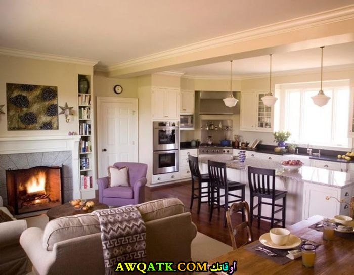 غرفة معيشة مفتوحة علي الصالة بسيطة وجميلة
