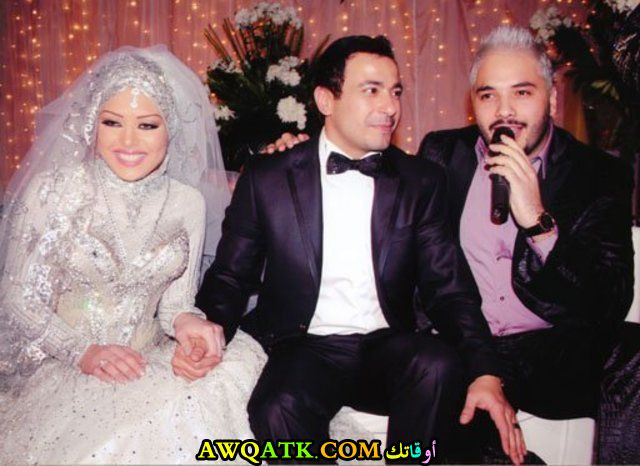 صورة عائلية للفنان محمد نجاتي مع زوجته