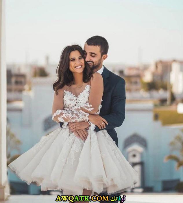 دينا داش وزوجها
